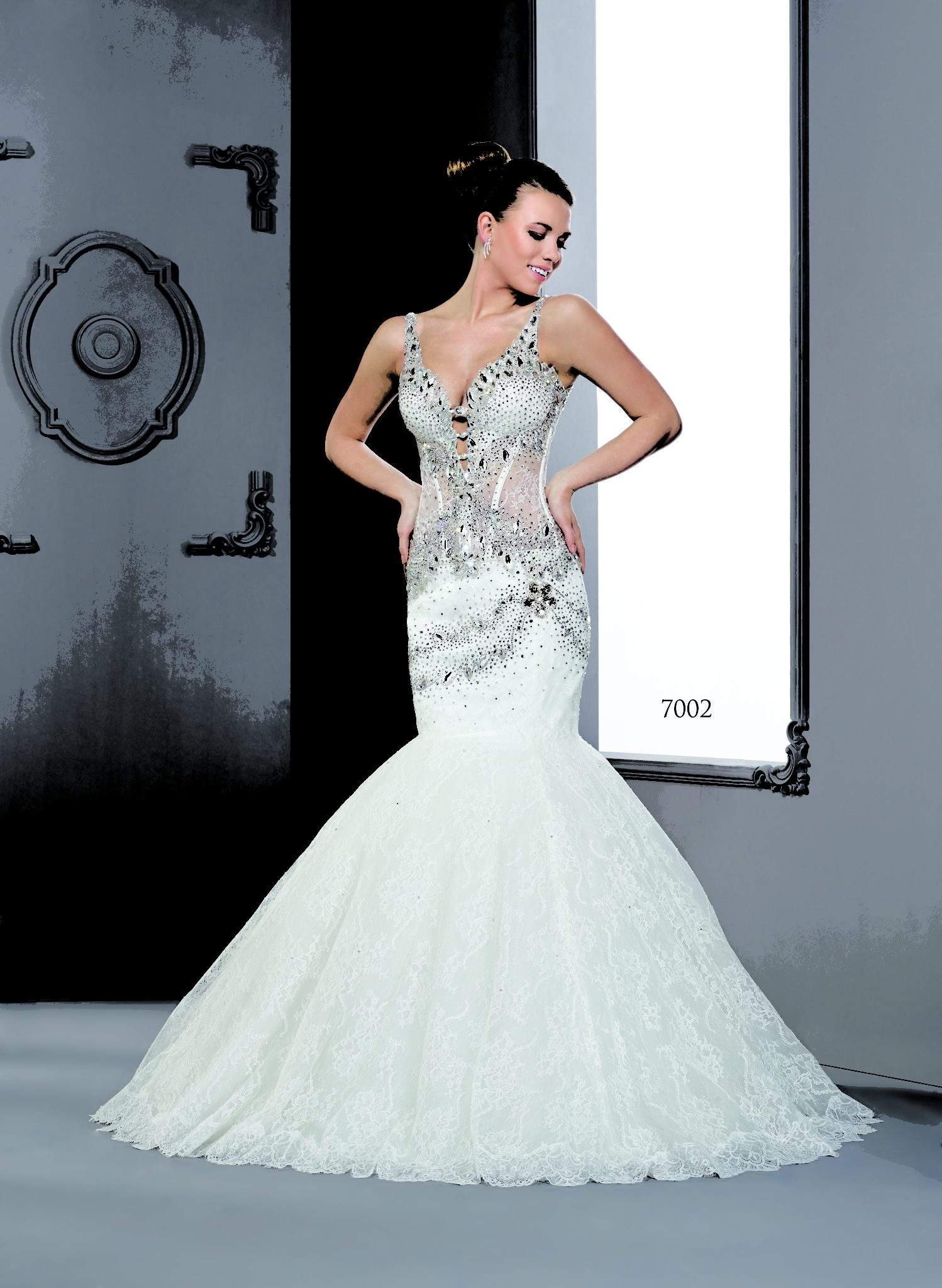 Heavily beaded wedding dresses with swarovski crystals by for Beaded wedding dress designers