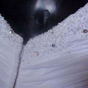 zipped white embroidered wedding gown