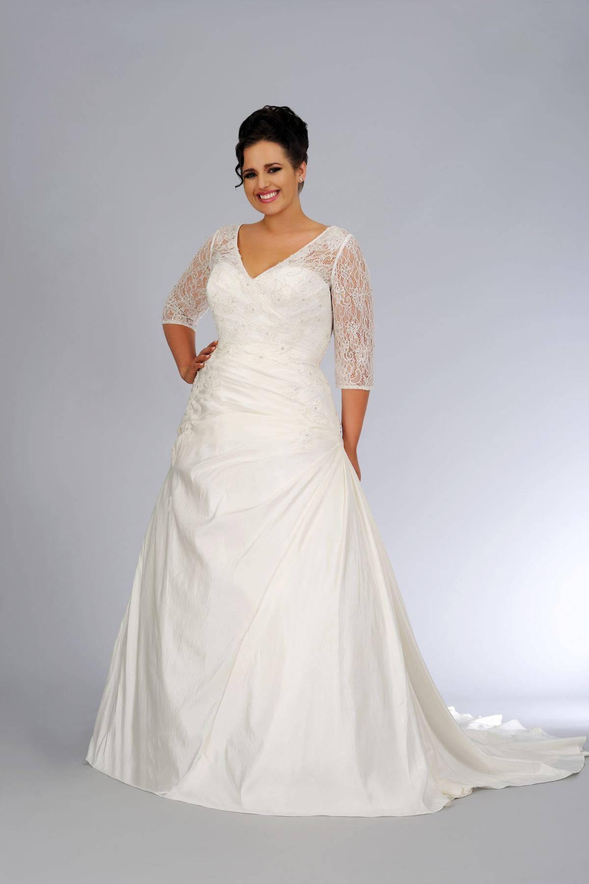 Plus Size 3/4 sleeve wedding gown by Darius Bridal