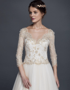 white and gold colored wedding gowns with long sleeves