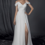 draping off the shoulder wedding gown with leg slit