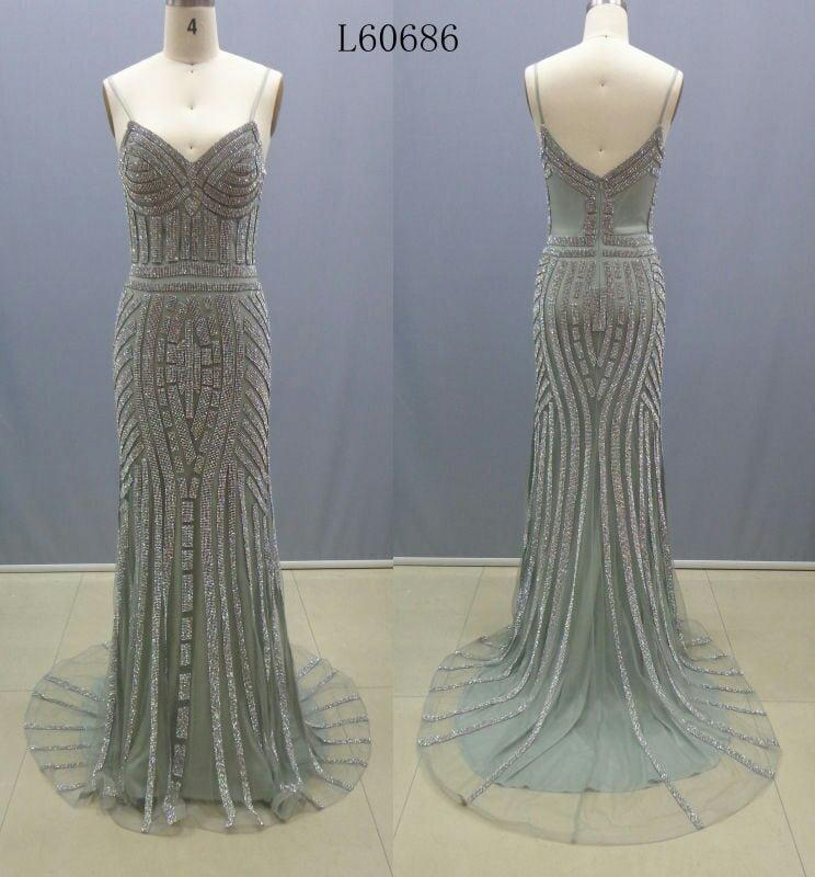 Gold beaded Pageant Gowns by Darius Couture