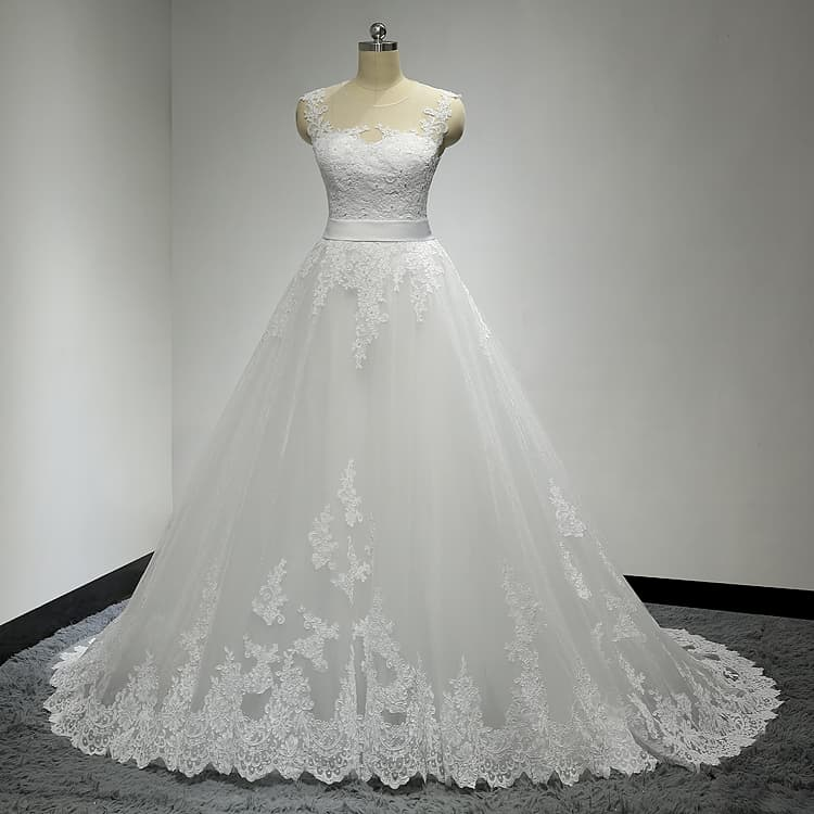 Sleeveless lace wedding gown with satin sash belt by Darius