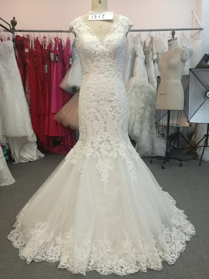 V-neck lace wedding gown with cap sleeves from Darius