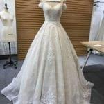 Style #222 off the shoulder lace bridal gown from Darius Cordell Couture