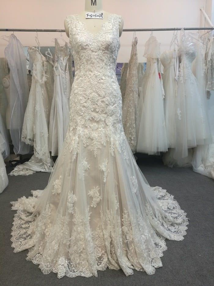 Embroidered Wedding Gown with sleeveless open neck line by Darius Bridal