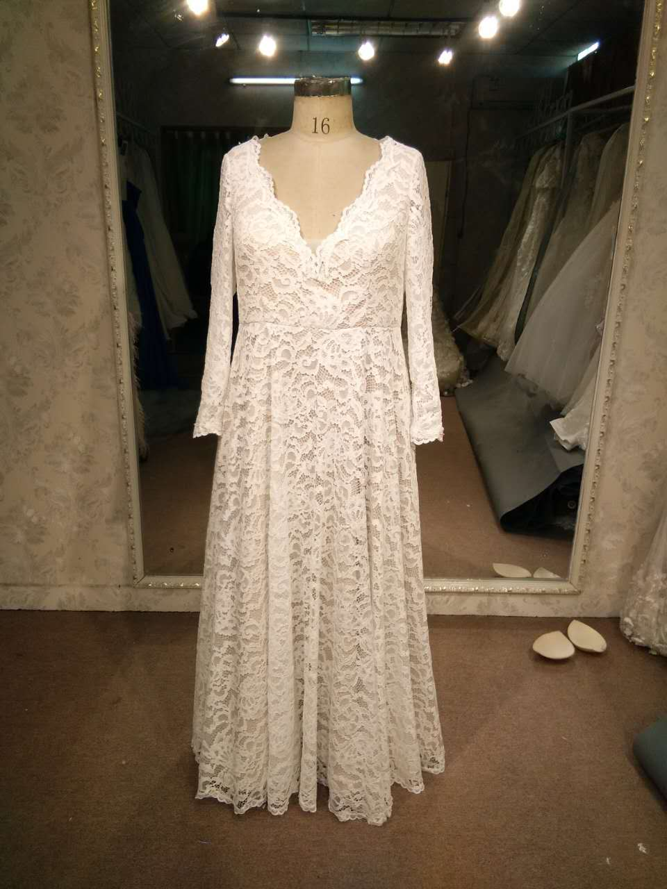 Long Sleeve plus size lace bridal gown with v-neck from Darius Bridal