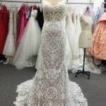 Style #2010683sun Embroidered wedding dress with open neck line from The Darius Collection