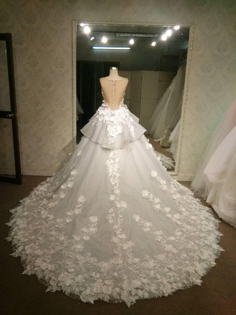 Peplum style flower wedding dress from Darius Bridal