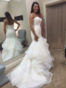 Strapless fit-to-flare style wedding dress with tiered flared skirt