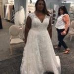 cap sleeve plus size wedding dress with v-neck line from Darius Bridal