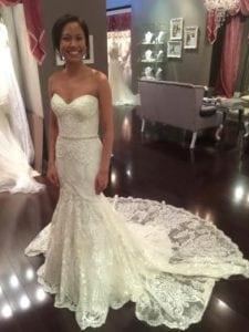 Pretty strapless lace wedding gown with train from Darius Bridal