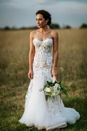 Fit-and-flare strapless wedding gown from Darius Bridal