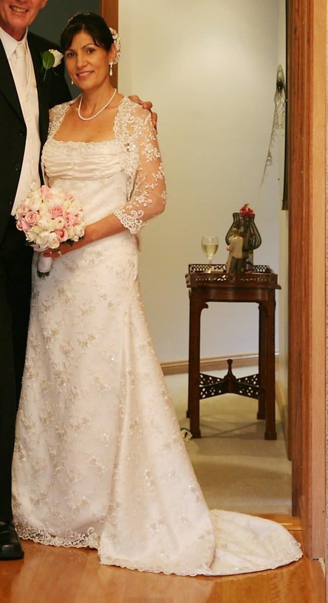 Wedding gown with shrug lace jacket from Darius Bridal