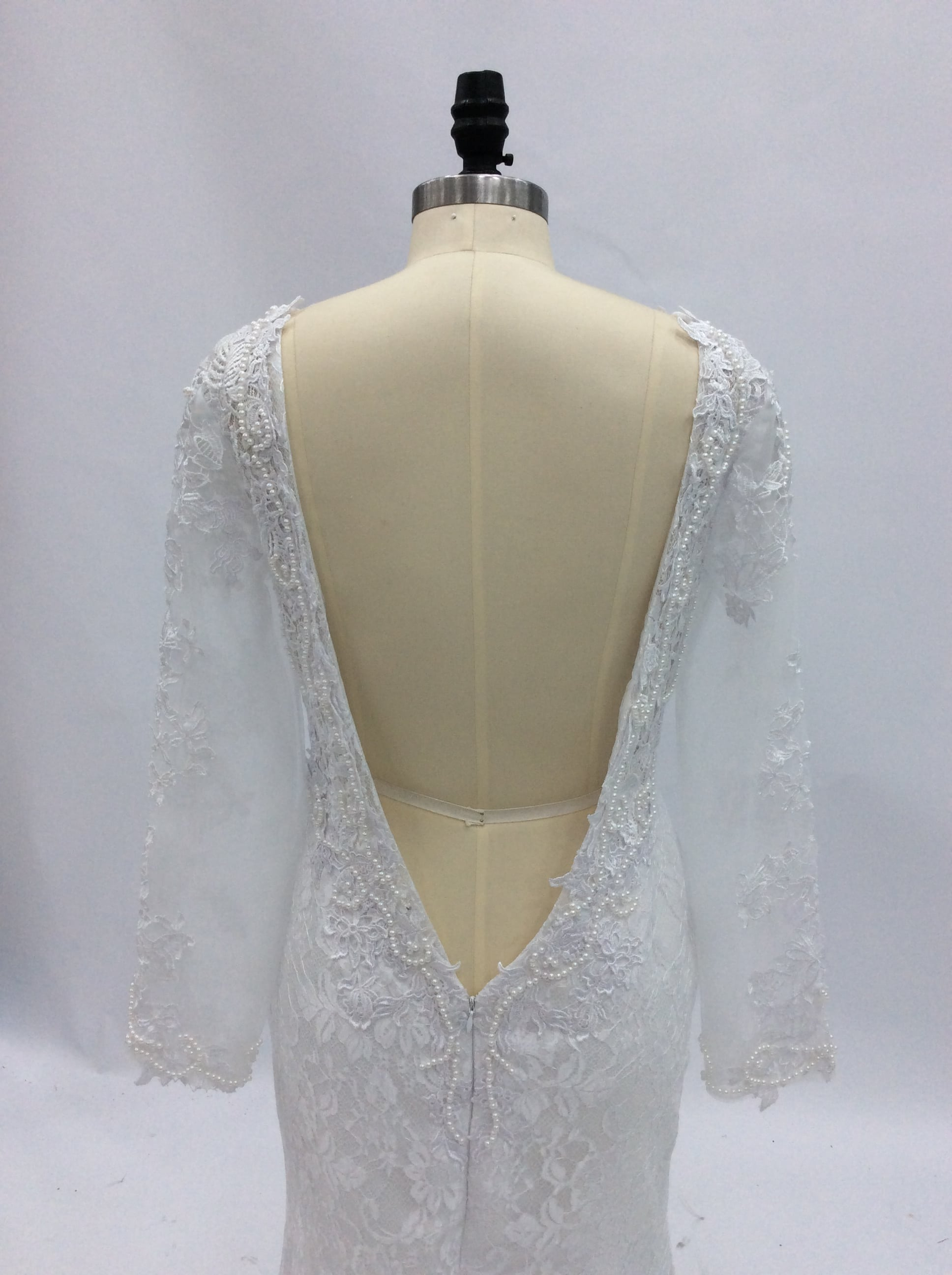 Ls0180382 v back lace long sleeve bridal gown from darius for Wedding dress sleeve attachments